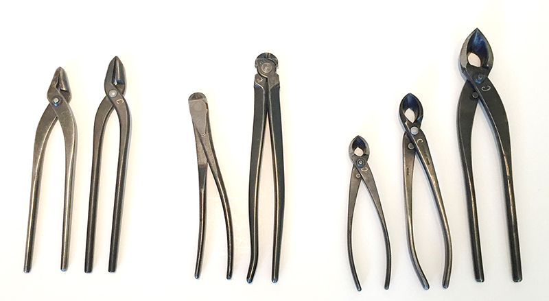 Multiple sizes of pliers, wire cutters and concave cutters